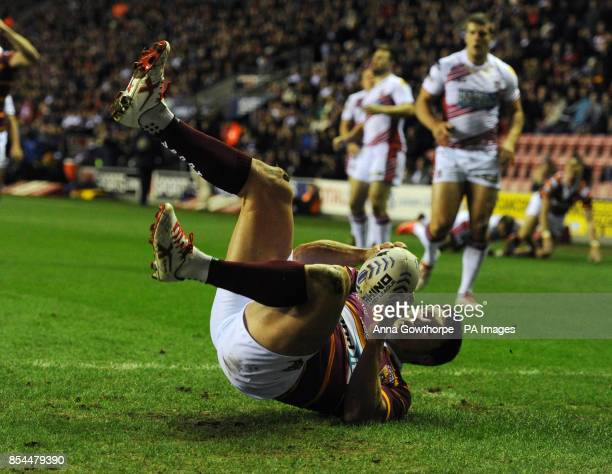 Huddersfield Giants Brett Ferres scores a try during the First Utility Rugby League match at the DW Stadium Wigan