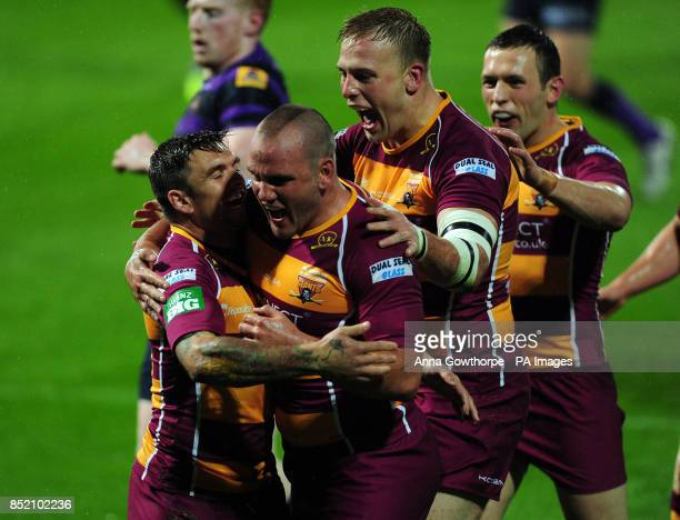 Huddersfield Giants Danny Brough celebrates with teammates after scoring a try during the Super League Elimination Play Off at the John Smith's...