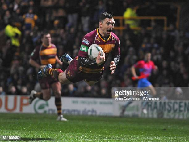 Huddersfield Giants' Danny Brough dives over to score a try during the Super League match at Headingley Carnegie Leeds