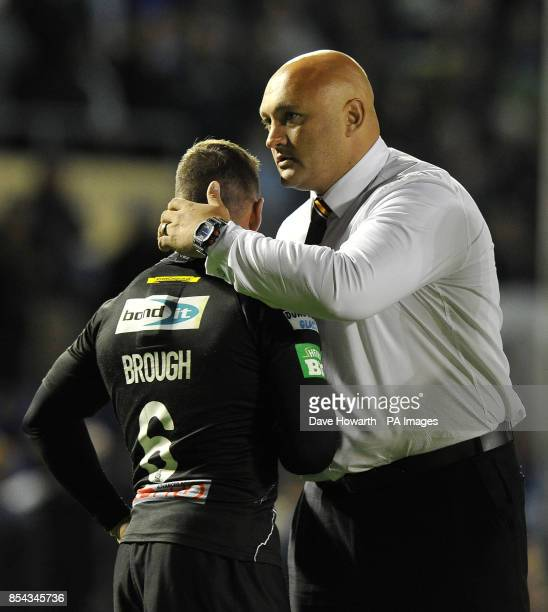 Huddersfield Giants' Danny Brough is consoled by Paul Anderson during the Super League SemiFinal match at The Halliwell Jones Stadium Warrington