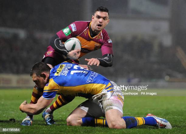 Huddersfield Giants' Danny Brough is tackled by Leeds Rhinos' Kevin Sinfield during the Super League match at Headingley Carnegie Leeds