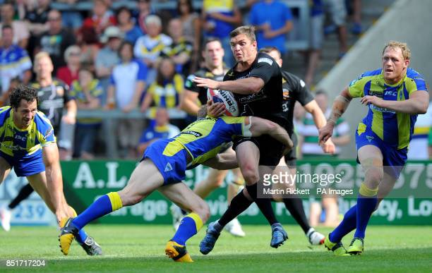 Huddersfield Giants Danny Brough is tackled by Warrington Wolves' Michael Monaghan during the Tetley's Challenge Cup Quarter Final at the Halliwell...