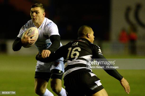 Huddersfield Giants Danny Brough is tackled by Widnes Vikings Willie Isa during the First Utility Super League match at the Select Security Stadium...