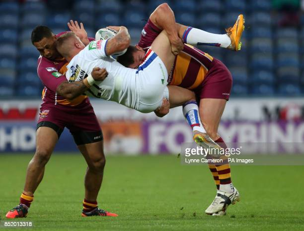 Huddersfield Giants Jason Chan and Brett Ferres tackle Wakefield Wildcat's Chris Annakin during the Super League match at the John Smith's Stadium...