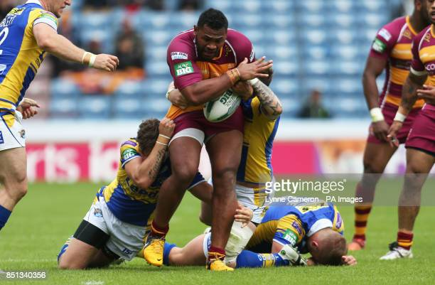 Huddersfield Giants Jermaine McGilvary tackled by Leeds Rhino's Thomas Minns and Paul McShane during the Super League match at The Galpharm Stadium...