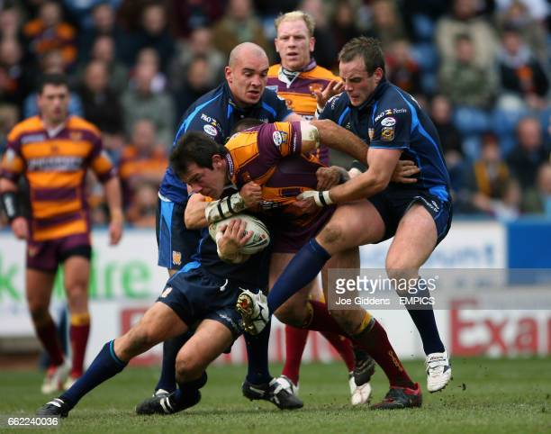 Huddersfield Giants' John Skandalis is tackled by Hull FC's Paul King and Ewan Dowes