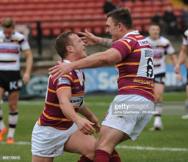 Huddersfield Giants' Luke Robinson celebrates with Danny Brough after scoring a try during the First Utility Super League match at the Odsal Stadium...