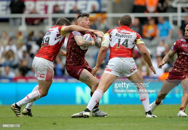 Huddersfield Giants' Oliver Roberts is tackled by Catalans Dragons' Mickael Simon and Julian Bousquet during day two of the Betfred Super League...
