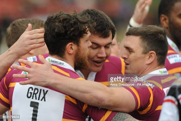 Huddersfield Giants' Scott Grix celebrates with Danny Brough after scoring a try during the First Utility Super League match at the Odsal Stadium...