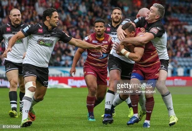 Huddersfield Giants's Danny Brough is tackled high by Widnes Vikings's Chris Houston during the Betfred Super League Round 21 match between...