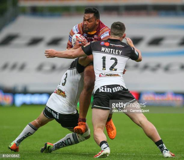 Huddersfield Giants's Ukuma Taai is tackled by Widnes Vikings's Matt Whitley and Hep Cahill during the Betfred Super League Round 21 match between...
