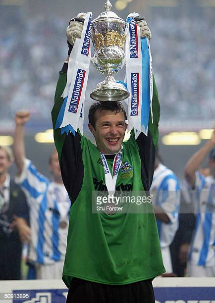 Huddersfield goalkeeper Paul Rachubka lifts the trophy after the Nationwide Division Three Play Off Final between Huddersfield Town and Mansfield...