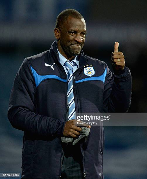 Huddersfield manager Chris Powell celebrates Jacob Butterfield's opening goal during the Sky Bet Championship match between Huddersfield Town and...