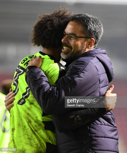 Huddersfield manager David Wagner celebrates with Izzy Brown after winning the Sky Bet Championship match between Rotherham United and Huddersfield...