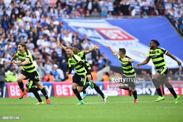 Huddersfield players celebrate after Huddersfield Town's German defender Christopher Schindler scores the final penalty in the shootout during the...