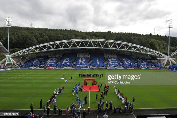Huddersfield Town and Newcastle United players line up before kickoff before the English Premier League football match between Huddersfield Town and...