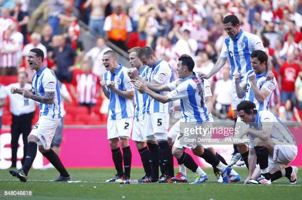 Huddersfield Town celebrate as Alex Smithies makes a save