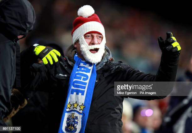 A Huddersfield Town fan in the stands during the Premier League match at the John Smith's Stadium Huddersfield