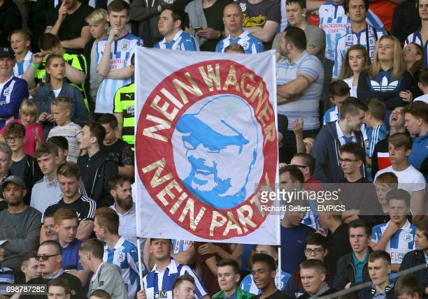 Huddersfield Town fans in the stands with a sign reading Nein Wagner Nein Party