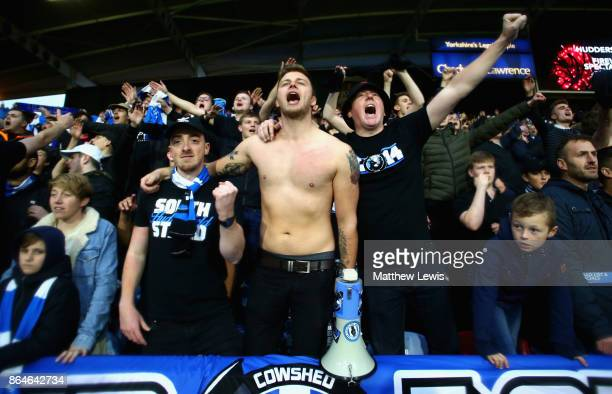 Huddersfield Town fans sing after the Premier League match between Huddersfield Town and Manchester United at John Smith's Stadium on October 21 2017...