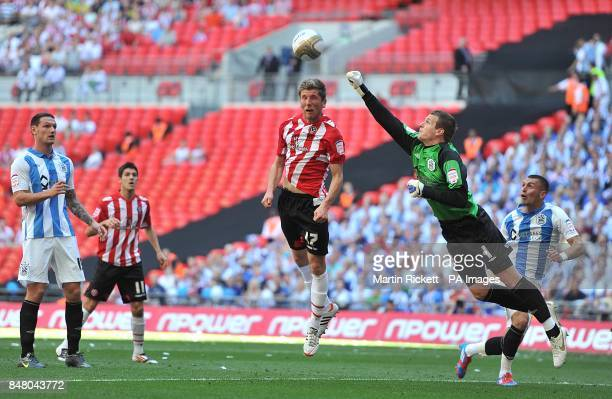 Huddersfield Town goalkeeper Alex Smithies punches the ball clear from Sheffield United's Richard Cresswell
