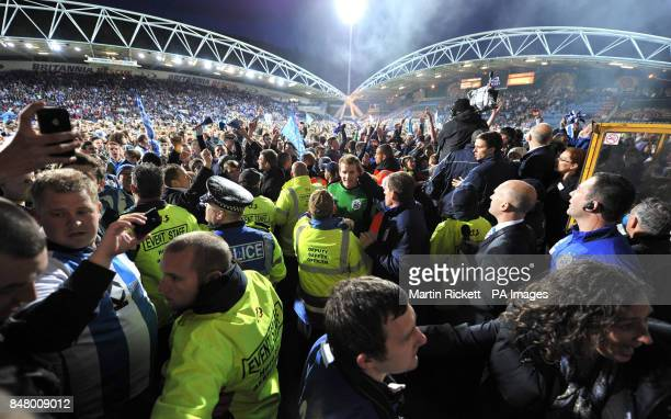 Huddersfield Town keeper Alex Smithies leaves the pitch as fans celebrate on the pitch after the npower Football League One Play Off Semi Final...