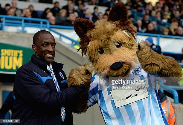 Huddersfield Town manager Chris Powell with Terry the Terrier ahead of the FA Cup Third Round match between Huddersfield Town and Reading at Galpharm...