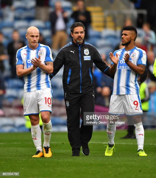 Huddersfield Town manager David Wagner with Aaron Mooy and Elias Kachunga after the Premier League match at Turf Moor Burnley