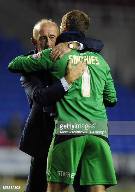 Huddersfield Town manager Mark Lillis celebrates his side's win with goalkeeper Alex Smithies after the Sky Bet Championship match at the Madejski...