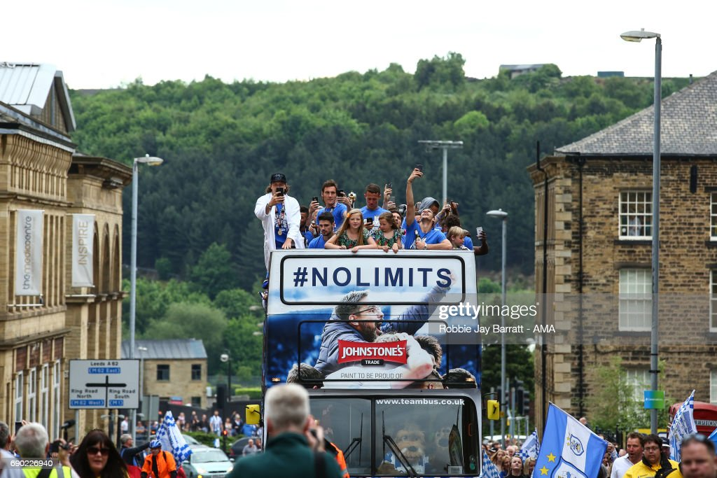 Huddersfield Town players and coaching staff on the open top bus on May 30, 2017 in Huddersfield, England.