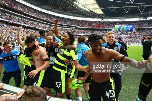 Huddersfield Town players celebrate after Christopher Schindler of Huddersfield Town scores the winning penalty during the Sky Bet Championship Play...