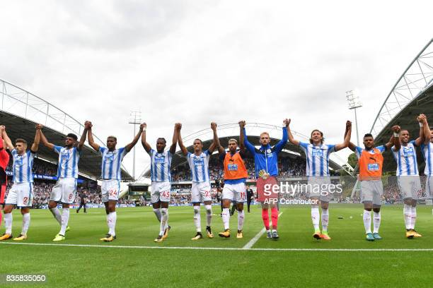 Huddersfield Town players celebrate victory after the English Premier League football match between Huddersfield Town and Newcastle United at the...