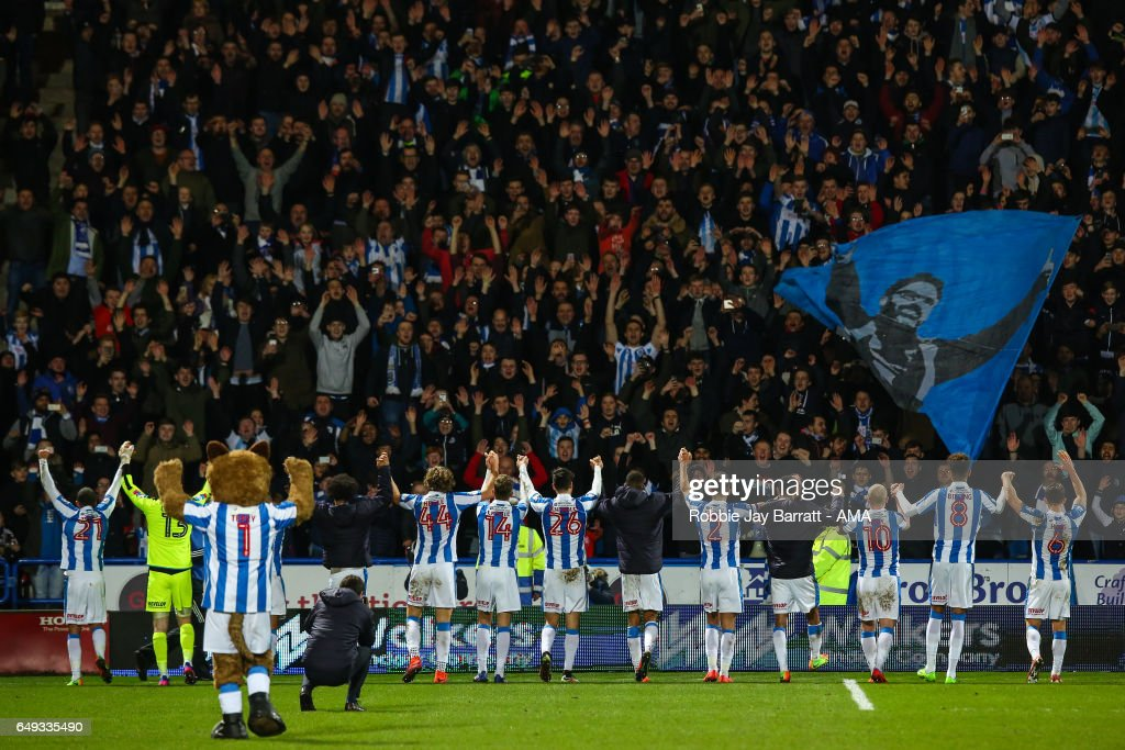 Huddersfield Town players celebrate with the fans at full time during the Sky Bet Championship match between Huddersfield Town and Aston Villa at John Smith's Stadium on March 7, 2017 in Huddersfield, England.