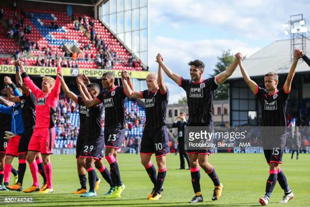 Huddersfield Town players celebrate with the fans at full time during the Premier League match between Crystal Palace and Huddersfield Town at...