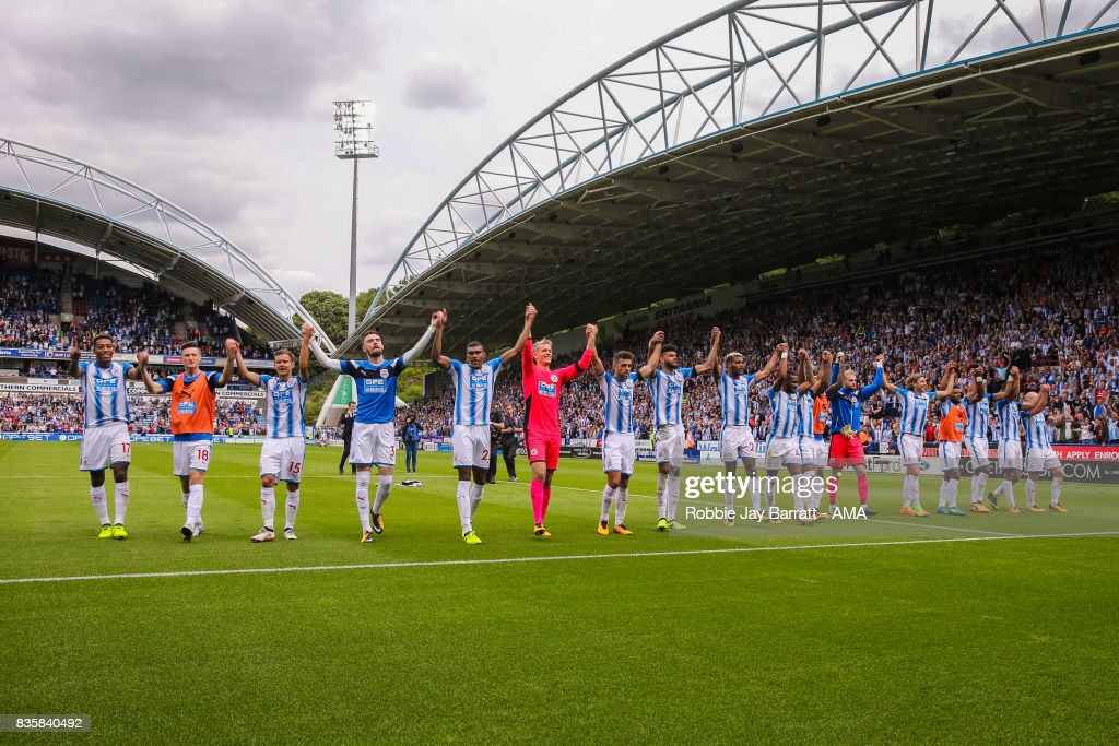 Huddersfield Town players celebrate with the fans at full time during the Premier League match between Huddersfield Town and Newcastle United at Galpharm Stadium on August 20, 2017 in Huddersfield, England.