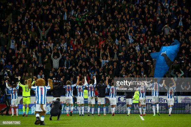 Huddersfield Town players celebrate with their fans at full time during the Sky Bet Championship match between Huddersfield Town and Aston Villa at...