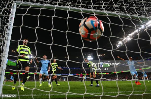 Huddersfield Town players react as Pablo Zabaleta of Manchester City celebrates as he scores their third goal during The Emirates FA Cup Fifth Round...