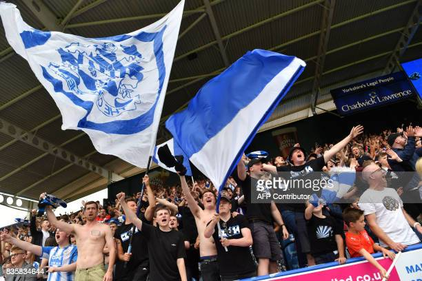 Huddersfield Town supporters celebrate victory after the English Premier League football match between Huddersfield Town and Newcastle United at the...