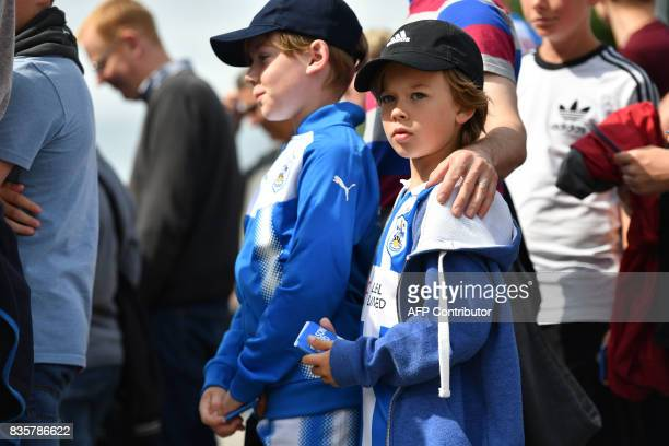 Huddersfield Town supporters gather outside the stadium prior to the English Premier League football match between Huddersfield Town and Newcastle...