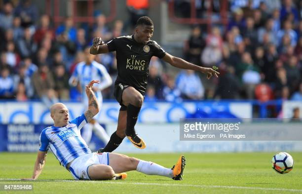 Huddersfield Town's Aaron Mooy and Leicester City's Kelechi Iheanacho battle for the ball during the Premier League match at the John Smith's Stadium...
