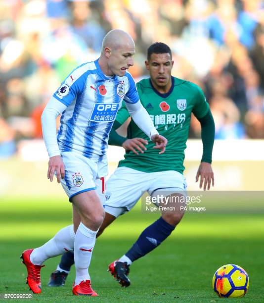 Huddersfield Town's Aaron Mooy and West Bromwich Albion's Salomon Rondon battle for the ball during the Premier League match at the John Smith's...