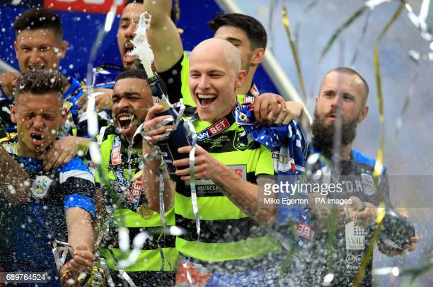 Huddersfield Town's Aaron Mooy celebrates winning the Sky Bet Championship playoff final at Wembley Stadium London