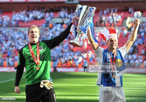 Huddersfield Town's Alex Smithies and Jack Hunt celebrate promotion to the Championship with the PlayOff Trophy