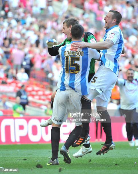 Huddersfield Town's Alex Smithies celebrates with team mates Steve Morrison and Peter Clarke after gaining promotion to the Championship