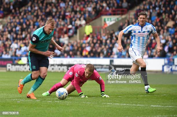 Huddersfield Town's Alex Smithies is grounded as Jordan Rhodes of Blackburn Rovers goes round him to have a shot on goal