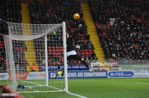 Huddersfield Town's Alex Smithies just manages to save an attempt from Charlton Athletic's Chris Eagles