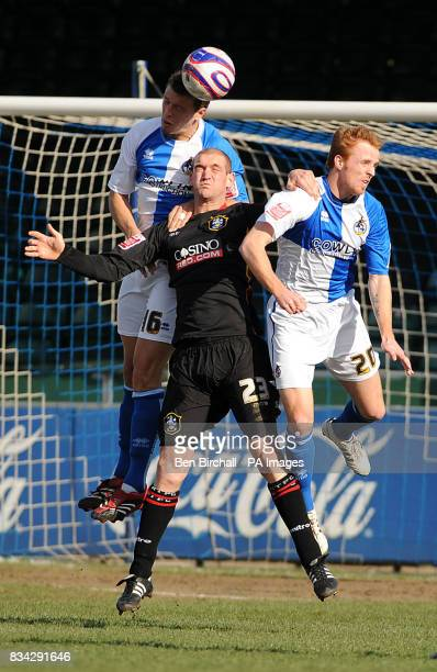 Huddersfield Town's Andy Booth is swamped during the first half as Rovers defend well with Danny Coles on the ball and Craig Disley in the air during...