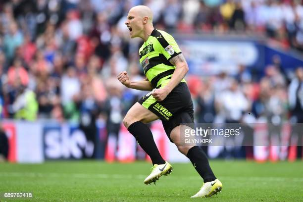 Huddersfield Town's Australian midfielder Aaron Mooy celebrates after scoring his penalty in the shootout during the English Championship playoff...