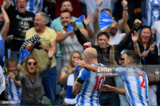 Huddersfield Town's Australian midfielder Aaron Mooy celebrates with Huddersfield Town's English defender Tommy Smith scoring the team's first goal...