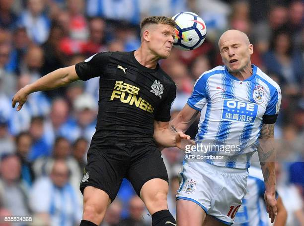 Huddersfield Town's Australian midfielder Aaron Mooy vies for the ball during the English Premier League football match between Huddersfield Town and...